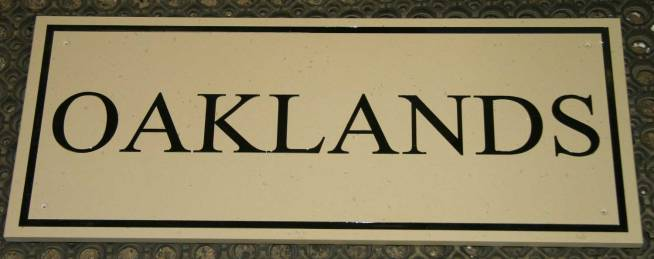 House sign engraved into stone like corian.