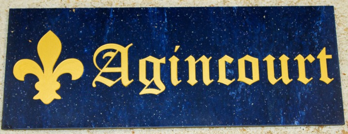 Colour Elderberry corian with gold text in the old english font