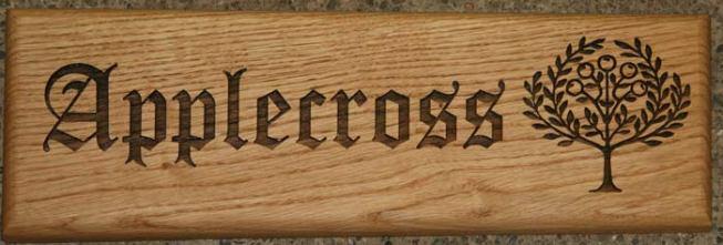 Elegant lettering on wooden House Sign