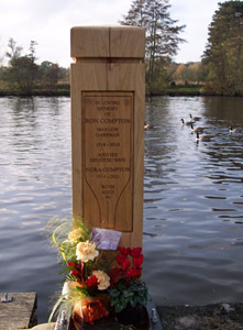 Oak plaque inlaid into wooden posts.