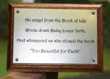 Memorial plaque on wooden tree stake