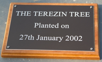 Black anodized aluminium memorial on a blacking board