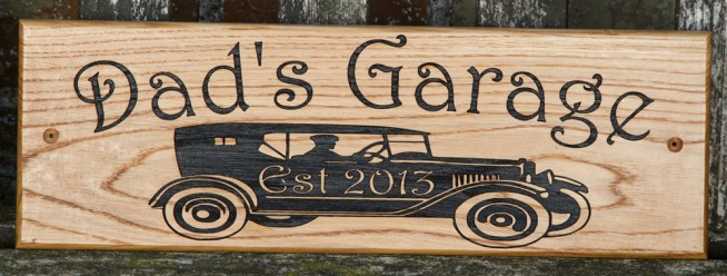 This lovely oak signs shows the detail we can create on a wooden sign. The font is Harrington. The image is an adjusted version of VS401 ref - 1312.LW.072. http://www.sign-maker.net/wooden/elegant-timber-signs.htm