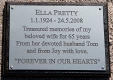 Engraved memorial plaque on black backing board.