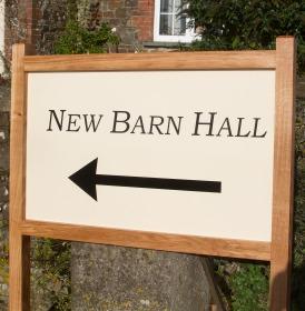 Entrance Sign - https://www.sign-maker.co.uk/oak-framed-entrance-signs-27652-p.asp