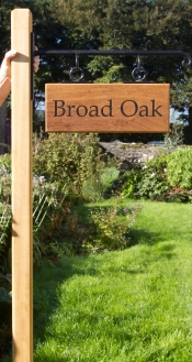 Hanging Iroko wood house sign.