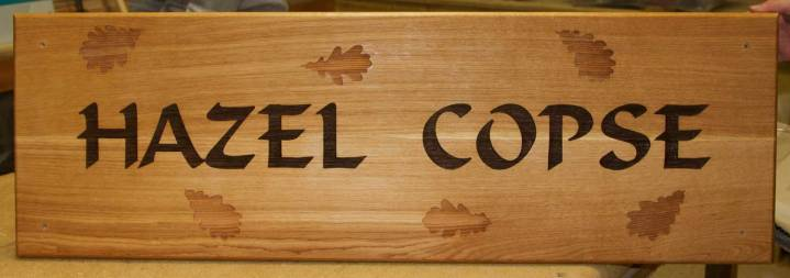 Large Oak Sign with unpainted leaf images.