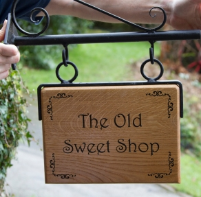 Hanging Oak house sign with fixed hanger and Scroll bracket with extra scroll