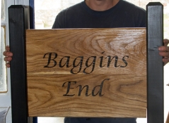 Oak sign morticed into 2 black painted softwood posts