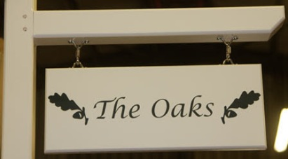 Painted wooden hanging sign