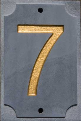 Slate house number with gold text.