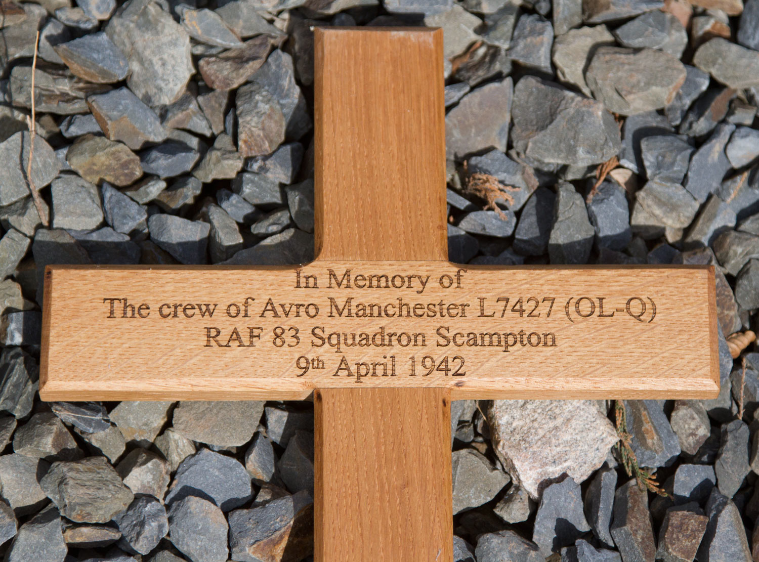 We make them in all kinds of materials  Cast bronze, engraved brass,  granite, slate, solid wood and wooden crosses.  http://www.sign-maker.net/memorial/ ...