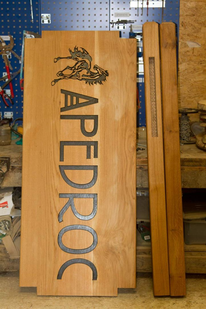 Large oak sign morticed into posts