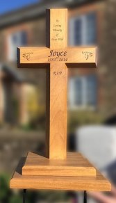 Special wooden memorial cross on a double plinth with wgought irin ground spikes