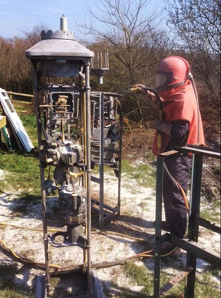 Sand blasting vintage petrol pump