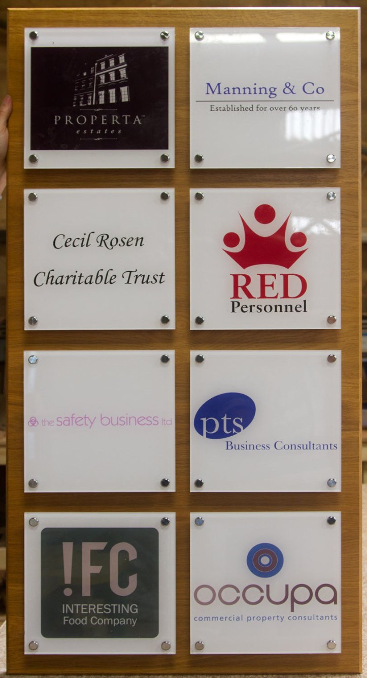Acrylic plaques on oak backing board
