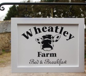 Framed Signs - https://www.sign-maker.co.uk/traditional-framed-signs-with-painted-lettering-23241-p.asp