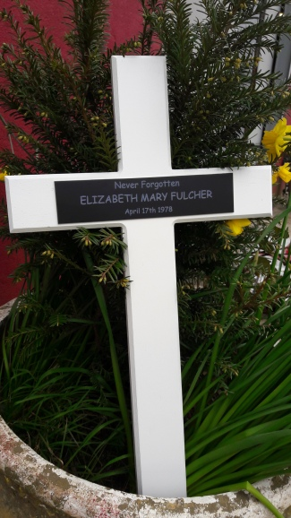 White painted Wooden cross with Black Anodised Aluminium Plaque
