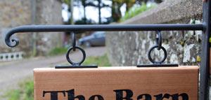 Scroll End Hanging Bracket - https://www.sign-maker.co.uk/hanging-signage-and-brackets-105-c.asp