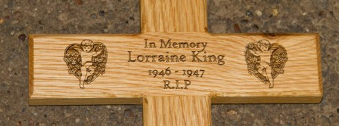 Engraved text on wooden Cross